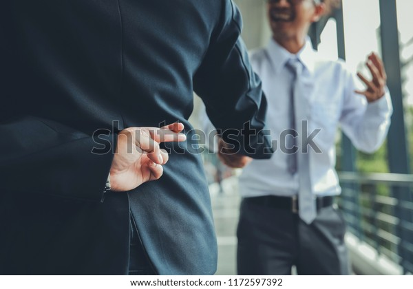 Trickery Conceptbusiness Partners Shaking Hands One Stock Photo