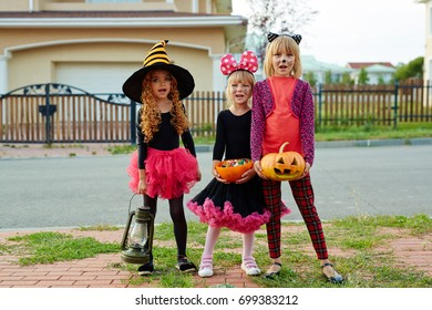 Trick-or-treat girls asking for candies on day of halloween