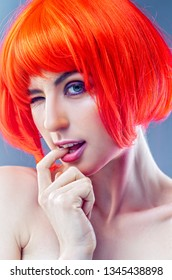 Tricky beauty. Funny female portrait withcrazy makeup end hair style