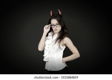 Tricky business lady. Girl red horns celebrate Halloween. Carnival concept. Trick or treat. Halloween costumes. Woman with imp style accessory Halloween party. Pretty teacher or office worker.