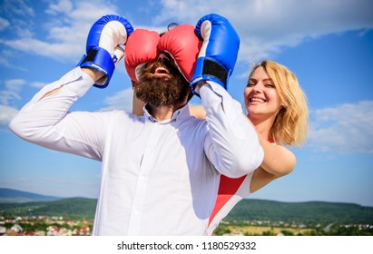 Tricky female. Relations game or struggle. Play and have fun. Tricks every woman needs to know. Girl smiling face covers male face boxing gloves. Break rules success. Dexterous tricks play relations.
