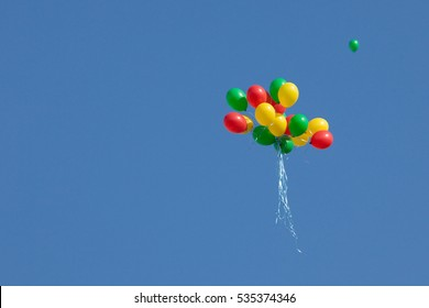 Tricolor balloons symbolizing Lithuanian flag flying during ceremony of hoisting flags on 20th Anniversary of Restoration of Independence of Lithuania on Mar 11, 2010