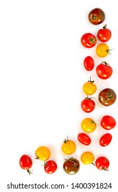 Tricolor cherry tomatoes border on white background in flat lay composition.  Vertical orientation with room for text.