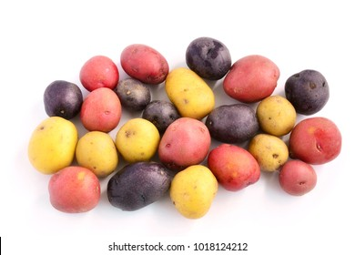 Tricolor mini potatoes on white background in horizontal format and shot in natural light