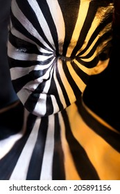 Tricolor spiral bodyart on the body of a young girl. Look like zebra pattern skin