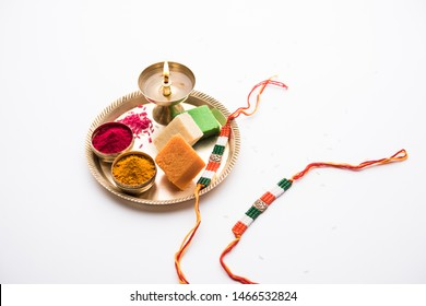 Tricolour Rakhi and Sweets for Independence Day / Raksha Bandhan which is on the Same Day in 2019, puja thali decorated with diya, haldi/kumkum and indian currency as gift