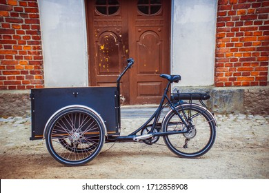 tricycle (bicycle) bike with a basket on the street