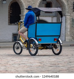 Tricycle taxi for tourists on city center street