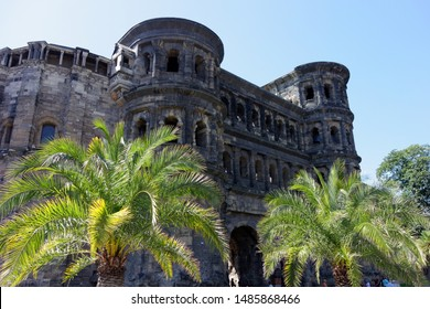 Trier, Germany - August 23, 2019: The Porta-Nigra (black gate) is a large Roman city gate in Trier, Germany. It is designated as part of the Roman Monuments in Trier UNESCO World Heritage Site.