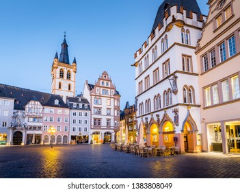 TRIER, GERMANY - MARCH 28, 2017: historic city center of Trier with famous Hauptmarkt market square and St. Gangolf church in beautiful post sunset twilight at dusk in summer, Rheinland-Pfalz, Germany