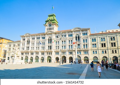 Trieste, Italy - 05.08.2015 : View of Trieste City Hall building in Itally with tourists passing by. Travel destination