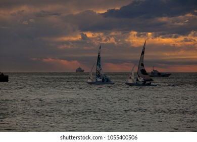 TRIESTE, ITALY - 06 OCTOBER 2017: Sailboats at sunset during the 49 Barcolana on 06 October, 2017