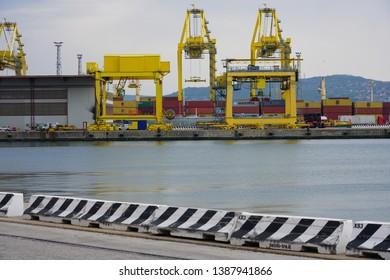 TRIESTE, ITALY -12 APR 2019- View of the Free Port of Trieste, a commercial port in the Adriatic Sea in the autonomous region of Friuli-Venezia Giulia in Italy.