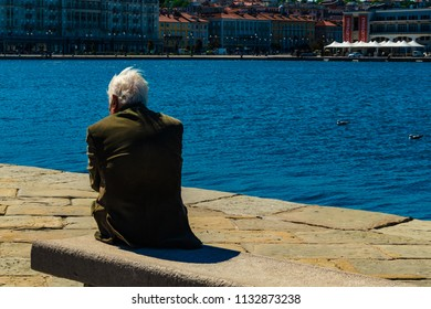 Trieste, Italy - 29 April 2017: An old man on Molo Audace