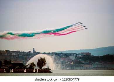 Trieste, Italy. 4/11/2018  Acrobatic air performance of Frecce tricolori -- tricolour arrows. Italian flag colors esebition for National Unity Day.