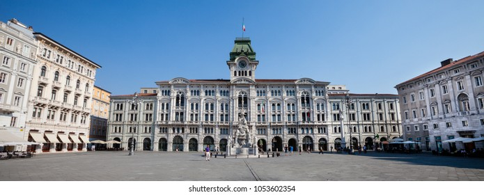 TRIESTE, ITALY. August 13, 2015: Piazza Unità d'Italia (Unity of Italy Square) main square in Trieste, a seaport city in northeast Italy. Located at the foot of the hill with the castle of San Giusto.