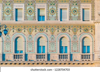 Trieste, Italy - August 27 2018: detail of the mosaic-decorated façade of Palazzo della Prefettura with coats of arms of the Savoy house created after the First World War