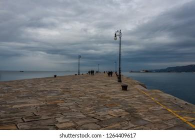 TRIESTE/ ITALY DEC 27 2017 - The Molo Audace pier of Trieste in a winter evening