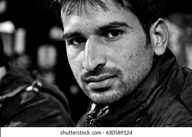 Trieste, Italy - December 25, 2013 : black and white portrait of Afghan refugee at Christmas dinner. editorial use