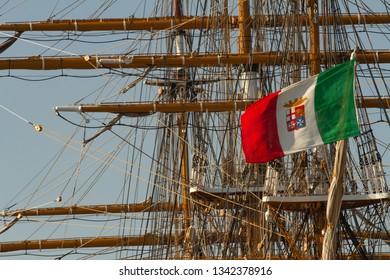 Trieste, Italy, Europe - 10/13/2018 - Barcolana race, 50th edition; italian flag on the Amerigo Vespucci ship.