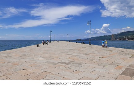 TRIESTE, ITALY - JULY 8 2018: People on the Molo Audace Historical pier on the Gulf of Trieste