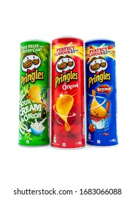 Trieste, Italy – March 25, 2020 : Pringles tubes three flavors isolated on white background. Pringles is an American brand of potato and wheat-based stackable snack chips. It is owned by Kellogg's.