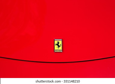 TRIESTE, ITALY - OCTOBER 09, 2015: the worldwide known Ferrari logo on a red Ferrari sport car parked in a public street of Trieste.