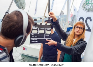 TRIESTE, ITALY - OCTOBER, 12: Girl holding clapperboard during the production of short film on October 12, 2014