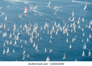 Trieste / Italy - October 14, 2018: Sailing boats competing in the Barcolana, a historic international crowded sailing regatta taking place in the Gulf of Trieste