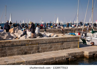 TRIESTE, ITALY - OCTOBER, 2018: People looking the sailboats during the 50° Barcolana regatta in Trieste on October 14, 2018