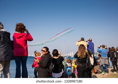 TRIESTE, ITALY - OCTOBER, 2018: People looking flying display and aerobatic show of Italian Frecce Tricolord uring the 50° Barcolana regatta in Trieste on October 14, 2018