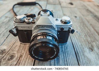 Trieste, Italy - October 24th 2017: Camera Canon AE-1 35mm ,Vintage SLR camera on wooden
