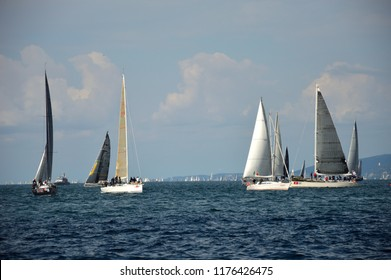 TRIESTE, ITALY, - October 8, 2017: group of sailboats at the 'Barcolana' race with cloudy sky in the background