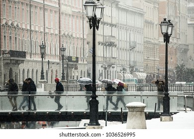 TRIESTE, ITALY-MARCH 1ST, 2018: Snow in trieste, people walking under snow in trieste downtown