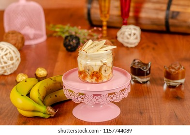 Trifle in a jar with tropical fruits  Banana slices