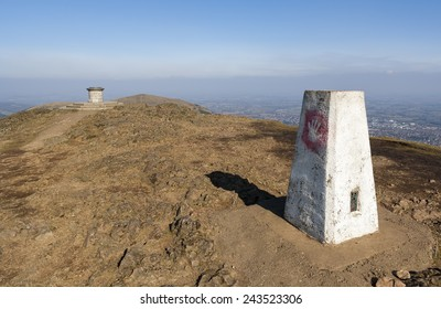 The Trig Point and Toposcope at the summit of the Worcestershire Beacon, Malvern Hills, UK.