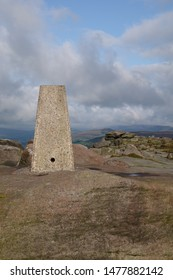 The trigonometry point on top of Stanage Edge in The Peak District National Park England.