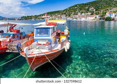 TRIKERI, GREECE - MAY 9, 2018: Traditional fishing boats lying in the harbor of Trikeri on the greek peninsula Pilion