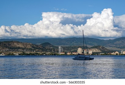 Trimaran Boat on Lake with Clouds