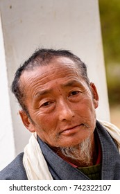 TRIMPHU, BHUTAN - MAR 8, 2017: Unidentified Ngalops old man in traditional clothes looks ahead. Ngalops is one of the most populous ethnic groups of Bhutan