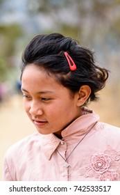 TRIMPHU, BHUTAN - MAR 8, 2017: Unidentified Ngalops beautiful little giirl looks ahead. Ngalops is one of the most populous ethnic groups of Bhutan