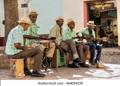 TRINIDAD - CUBA / 10.03.2015: Cuban street musicians are performing in Trinidad