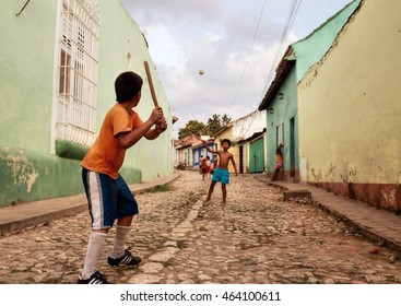 TRINIDAD - CUBA / 12.03.2015: Kids are playing baseball in the streets in Trinidad