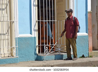 Trinidad, Cuba - April 27, 2016: Blind man with white cane