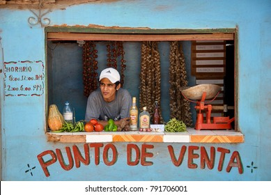 Trinidad / Cuba - April 7th 2014: A man waits in a rare, government licensed, private business selling basic goods with the name 'point of sale' written on the wall. 2014 marked the first licences.