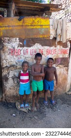 TRINIDAD, CUBA - August 16, 2006: three unidentified children on August 16, 2006 in Trinidad, Cuba, standing in front of an old, poor house.