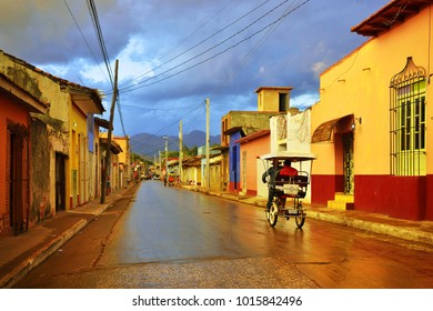 Trinidad, Cuba. Beautiful street with colorful colonial traditional houses and cuban taxi bicycle. Trinidad is a UNESCO listed city and popular destination.