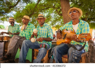 TRINIDAD, CUBA - CIRCA AUGUST 2015: Traditional Cuban musicians playing songs for tourists in Trinidad, Cuba