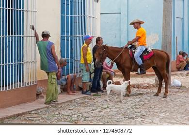 Trinidad, Cuba – December 26, 2018: Group of people talking in Trinidad of Cuba