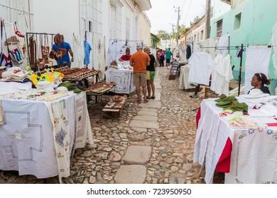 TRINIDAD, CUBA - FEB 8, 2016: Cobbled street and a market in the center of Trinidad, Cuba.